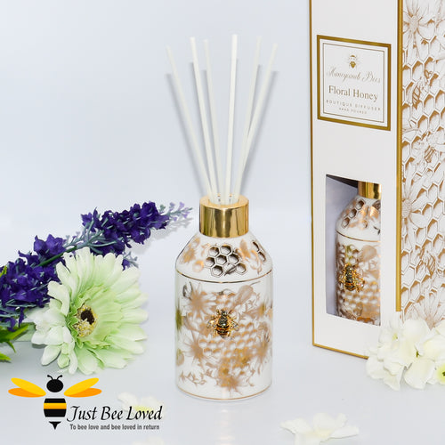 floral fragrance infused with the scent of honeycomb presented in a ceramic diffuser bottle decorated with golden honeycomb and flowers with a 3D bee central embellishment.