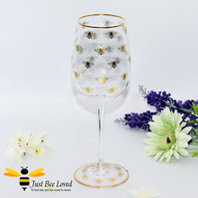 Load image into Gallery viewer, tall stemmed wine glass decorated with golden bees and gold rim