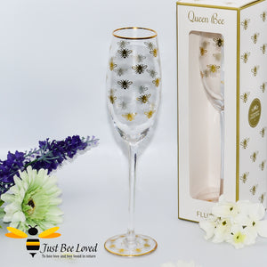 tall stemmed champagne flute glass decorated with golden bees and gold rim