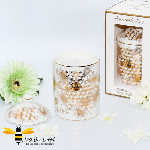 scented candle with a floral fragrance infused with honey; encased within an ivory fine China jar decorated with golden honeycomb and flowers with bee embellishment.