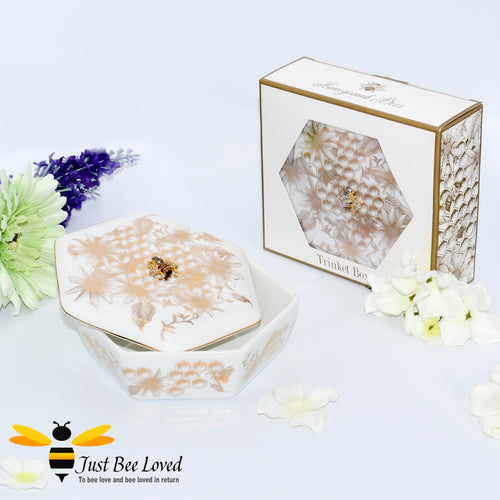 Fine china accessory trinket box decorated with golden honeycomb, bees and flowers, with a rhinestone bee embellishment.