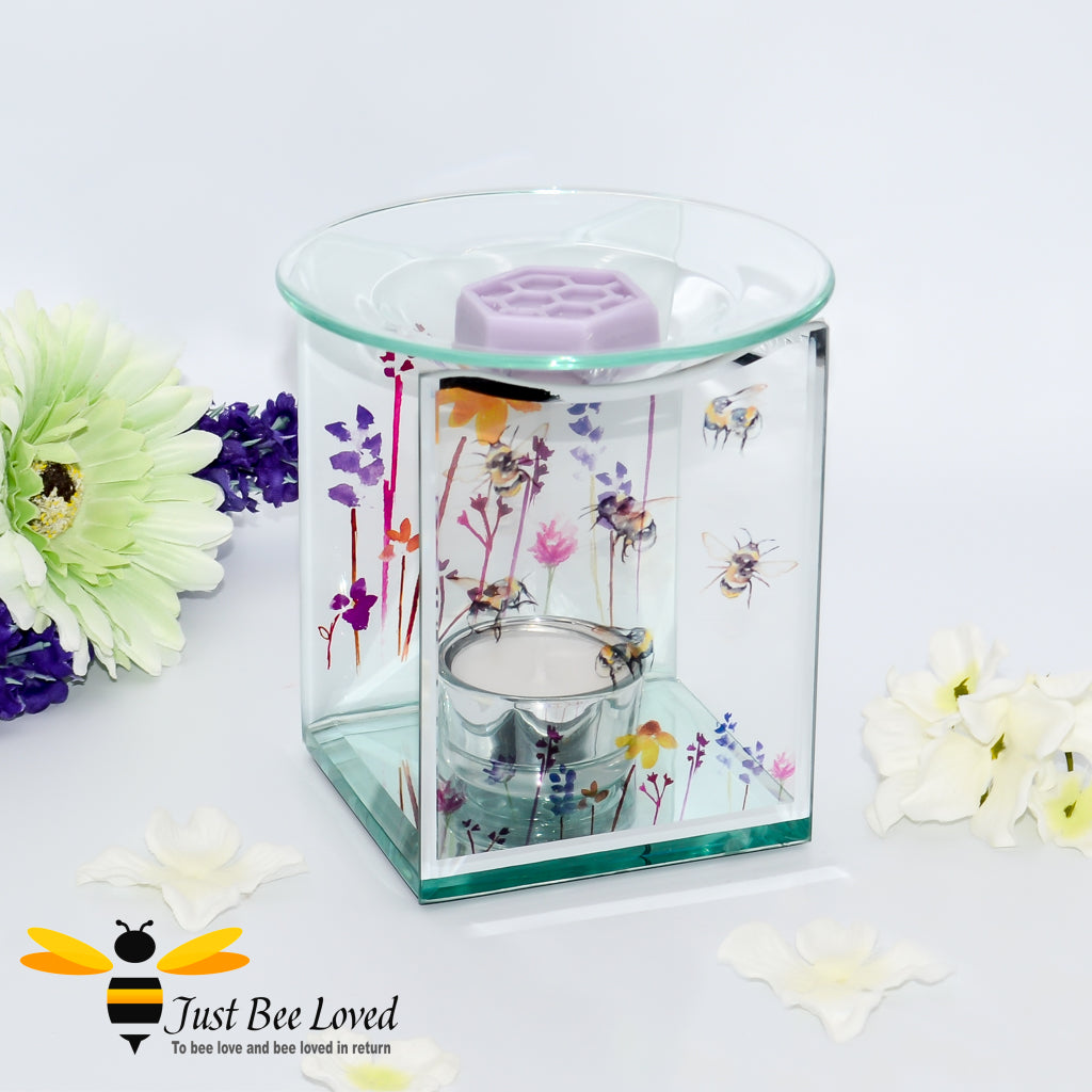 glass oil & wax melt burner featuring a clear front face decorated with flying bumblebees and matching lavender flowers on back.