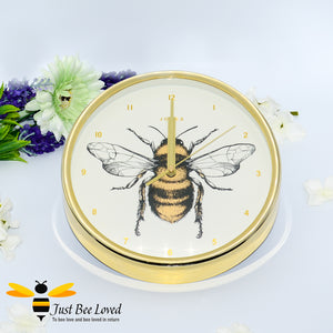 crafted round wall clock; designed with a gold rim casing and featuring a stunning bumblebee central print with gold Arabic dial and matching hands.