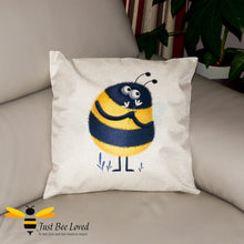 Load image into Gallery viewer, Large scatter cushion featuring a colourful image of a sweet bumblebee presenting flowers on a natural background.