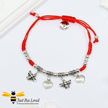 Load image into Gallery viewer, Handmade bohemian gypsy styled red rope bracelet featuring two silver colour bees and two love-heart pendants with beads.