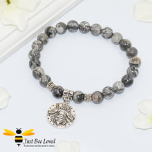 Load image into Gallery viewer, Handmade mottled grey natural stone bead bracelet featuring silver bee charm.