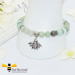 green bead bracelet featuring antique silver bee charm pendant.