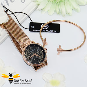 stainless steel mesh watch featuring 3D carved flower dial face encrusted with 12 diamond-like rhinestones for each hour and comes paired with matching rose gold twin bee bangle