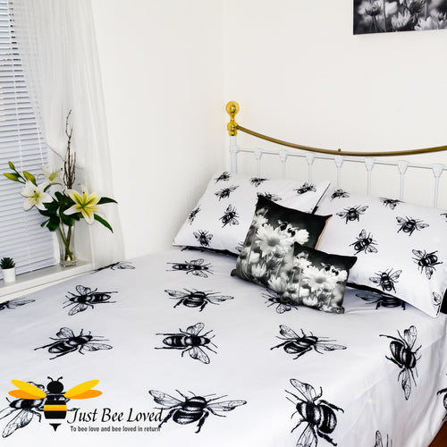duvet bedding set featuring a bold black and white design print of large bees with matching pillow cases.
