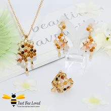 Load image into Gallery viewer, gold plated 3 piece jewellery set featuring golden honey drips, enamelled filled honeycomb to look like pollen with a honeybee.
