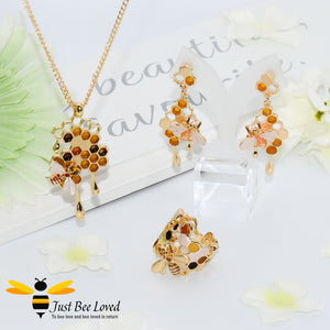 gold plated 3 piece jewellery set featuring golden honey drips, enamelled filled honeycomb to look like pollen with a honeybee.