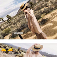 Load image into Gallery viewer, Brown women's straw panama hat with black band and bee embellishment