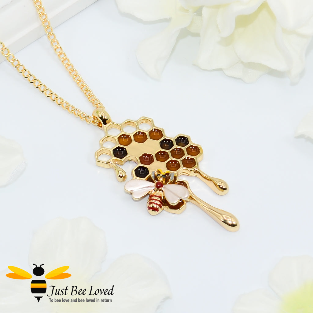 gold plated pendant necklaces each featuring golden honey drips, enamelled filled honeycomb to look like pollen with a honeybee.
