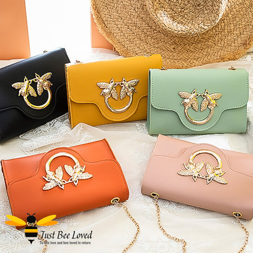 Just Bee Loved Elegant mini soft pu leather handbag with gold chain strap featuring large twin bees link embellishment in five colours, black, mustard, light green, orange and salmon pink