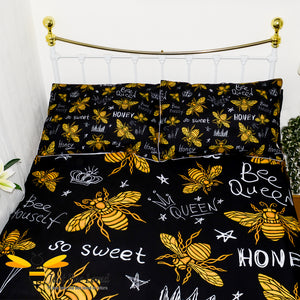 queen honey bee duvet bedding set featuring golden honey bees with stars, crowns and bee related statements print