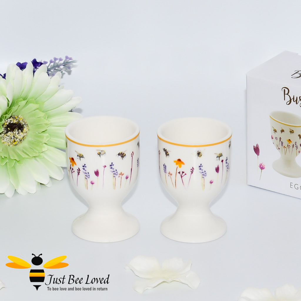 set of two matching egg cups featuring colourful watercolour design of bumblebees and lavender flowers.