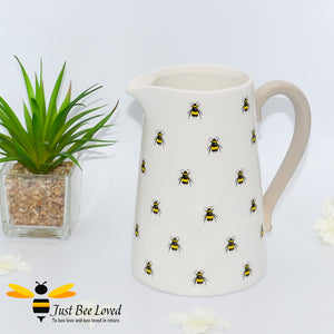 ivory ceramic flower jug featuring a decorative design of bumblebees with contrasting beige handle