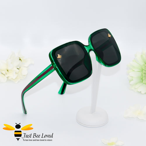 oversized retro styled square sunglasses featuring sweet gold bees on each lens in dark green colour