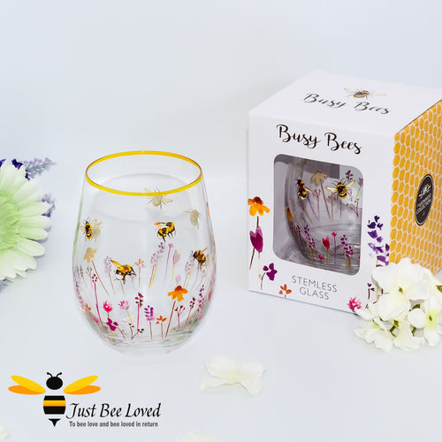 stemless wine glass decorated with watercolour design of bumblebees and lavender flowers with gold rim