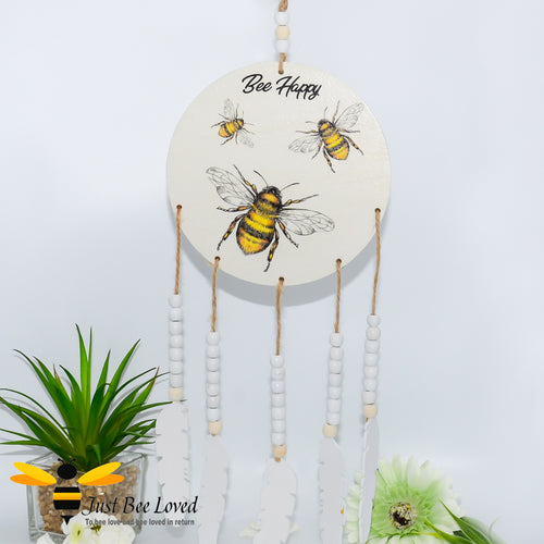 wooden feathered dream catcher; hand decoupaged with a family of bees with