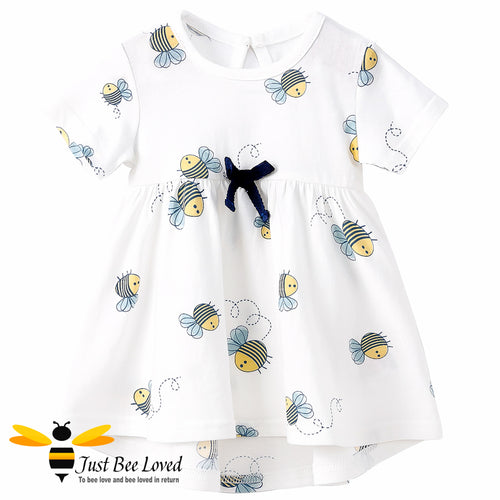 short sleeved white swing dress featuring an all over pretty little bees print decorated with a coordinating navy bow.