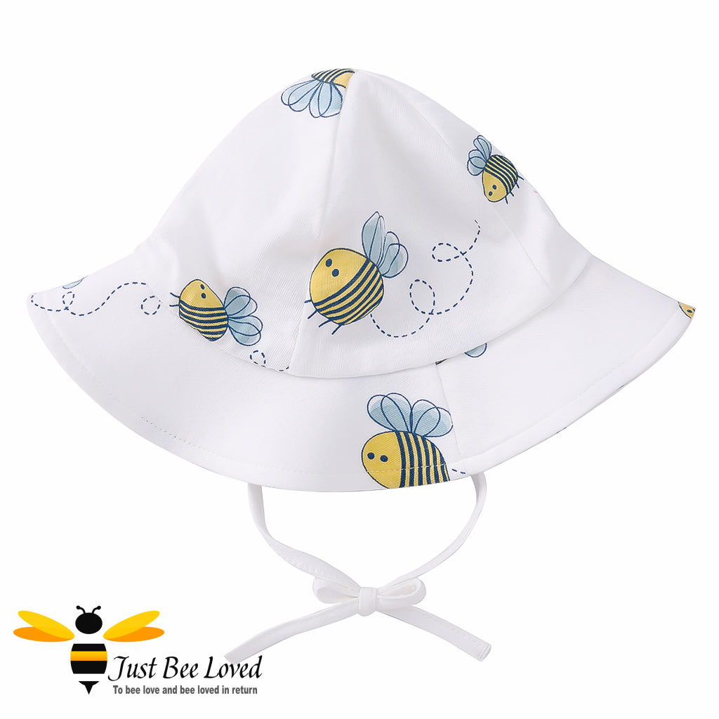 Baby Girls ivory floppy sun hat featuring an all over pretty little bees print.