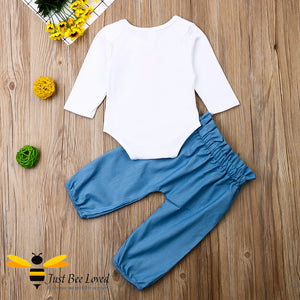 "2-piece set featuring a white bodysuit with bees and flowers and the message ""bee you"" matched with coordinating harem styled blue pants."