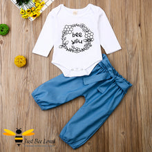 "Load image into Gallery viewer, 2-piece set featuring a white bodysuit with bees and flowers and the message ""bee you"" matched with coordinating harem styled blue pants."