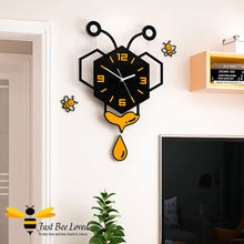 Load image into Gallery viewer, large honey bee hexagon pendulum wall clock with wall decor bees.