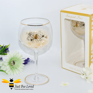 tall stemmed balloon gin glass decorated with golden honeycomb with 3D crystal bee and gold rim