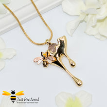 Load image into Gallery viewer, gold plated pendant necklaces each featuring golden honey drips, enamelled filled honeycomb to look like pollen with a honeybee.
