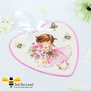 Handmade decoupaged wooden love heart plaque painted and decorated with bumblebees and cute girl holding a bunch of flowers