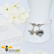 "Load image into Gallery viewer, handmade Shamballa wish mother bracelet in white featuring a bee and love heart engraved with ""Mom"" with sentimental verse card"