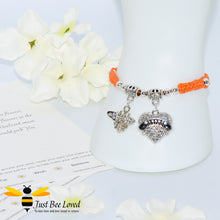 "Load image into Gallery viewer, handmade Shamballa wish mother bracelet in orange featuring a bee and love heart engraved with ""Mom"" with sentimental verse card"