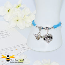 "Load image into Gallery viewer, handmade Shamballa wish mother bracelet in light blue featuring a bee and love heart engraved with ""Mom"" with sentimental verse card"