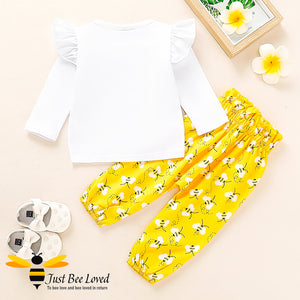 "Baby girl fashionable 2 piece set featuring a white long sleeved top with ""One Bee"" print matched with lovely harem styled bees printed yellow trousers."
