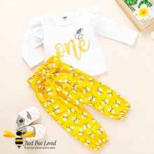 "Load image into Gallery viewer, Baby girl fashionable 2 piece set featuring a white long sleeved top with ""One Bee"" print matched with lovely harem styled bees printed yellow trousers."