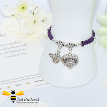 "Load image into Gallery viewer, handmade purple Shamballa wish charm bracelet featuring a bee and love heart engraved with ""Sister"" with sentimental verse display card"