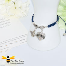 "Load image into Gallery viewer, handmade navy Shamballa wish charm bracelet featuring a bee and love heart engraved with ""Sister"" with sentimental verse display card"