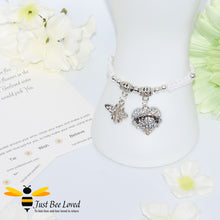 "Load image into Gallery viewer, handmade white Shamballa wish charm bracelet featuring a bee and love heart engraved with ""Sister"" with sentimental verse display card"