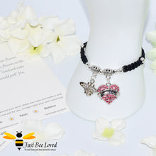"Load image into Gallery viewer, handmade black Shamballa wish charm bracelet featuring a bee and pink love heart engraved with ""Sister"" with sentimental verse display card"