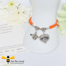 "Load image into Gallery viewer, handmade orange Shamballa wish charm bracelet featuring a bee and love heart engraved with ""Sister"" with sentimental verse display card"
