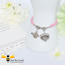 "Load image into Gallery viewer, handmade pink Shamballa wish charm bracelet featuring a bee and love heart engraved with ""Sister"" with sentimental verse display card"