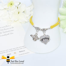 "Load image into Gallery viewer, handmade yellow Shamballa wish charm bracelet featuring a bee and love heart engraved with ""Sister"" with sentimental verse display card"