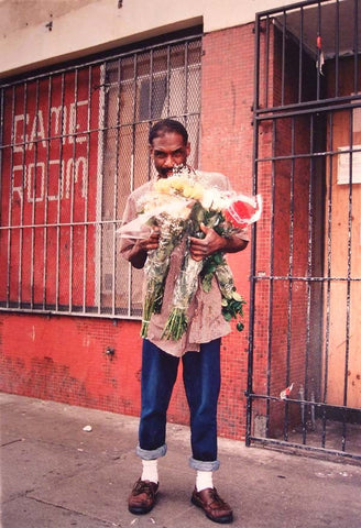 DAVE SCHUBERT - Man with flowers 6th St. 2002