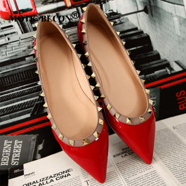 pointed tips and rivets and flat shoes