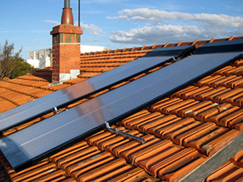 Two SolaMate panels on tile roof