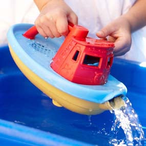 Waterfall-Making from Spout of Green Toy Tugboat
