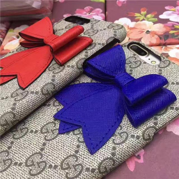 Gucci Leather embroidered bow case
