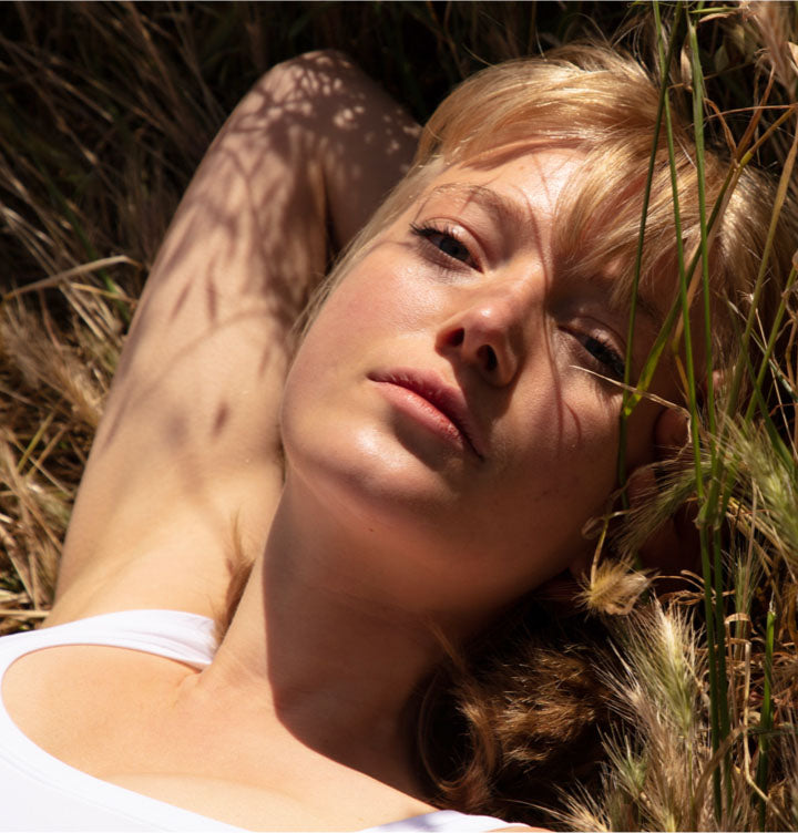 Woman laying in grass